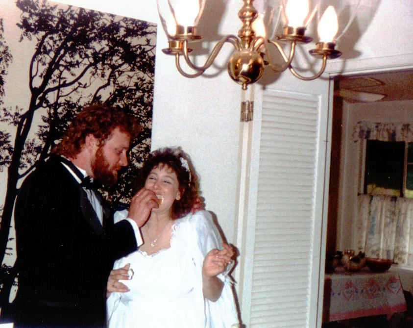 Terry & Gail Eating Wedding Cake